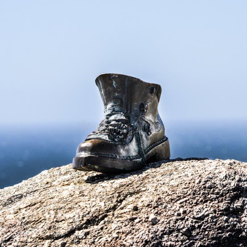 Metall på den Finisterre fyren, Camino Santiago, Galicia, Spanien arkivfoto