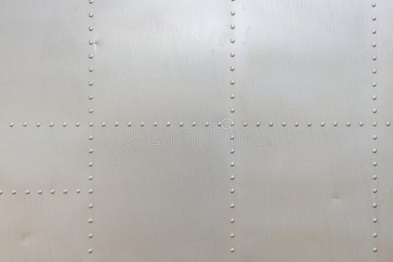 metallaluminiumyttersida av texturen för flygplanflygkropp fotografering för bildbyråer