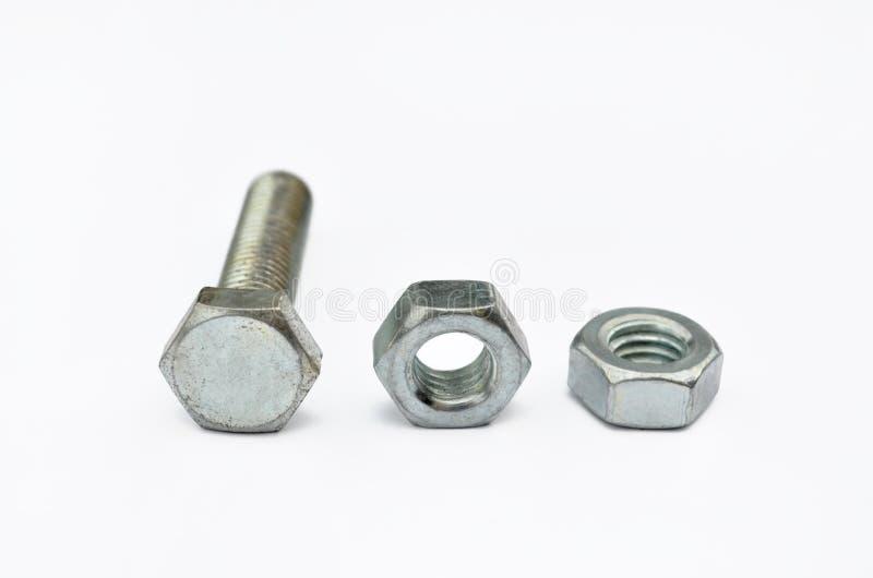 Metallbolzen und -nüsse für Bau stockfoto