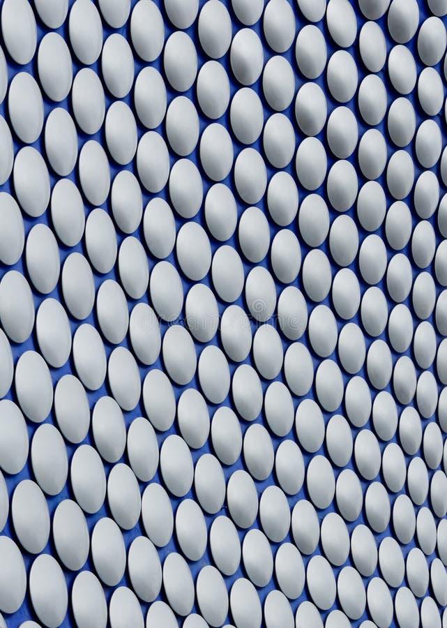 Metalldisketter på blå bakgrund royaltyfri bild