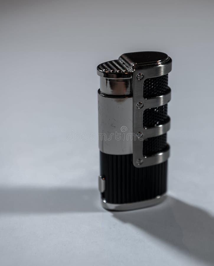 Metallfeuerzeug schwarz und mit Kombination lizenzfreies stockbild