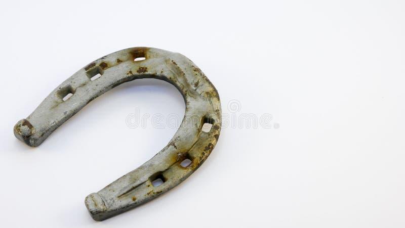 Metallhufeisen lokalisiert auf einem weißen Hintergrund lizenzfreies stockfoto