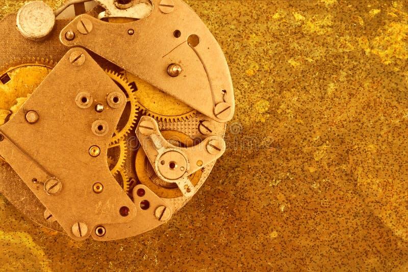 Metallic background with clockwork stock images