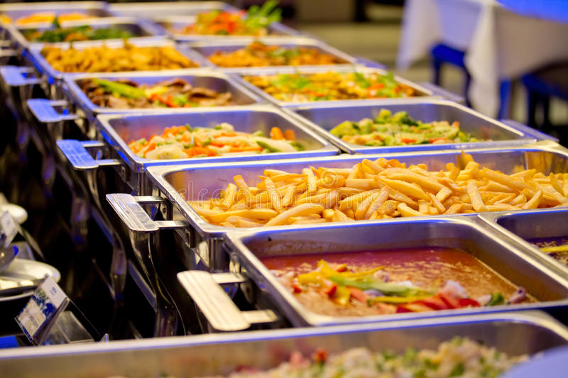 A Groups of Metallic Banquet Buffet Meal on Trays. Include french fried, vegetables and many foods stock image