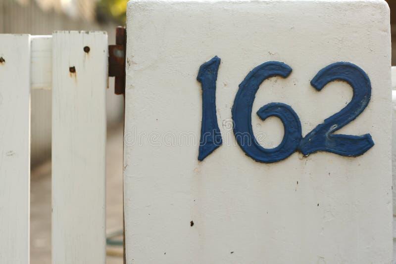 Metallic blue house numbers on white picke stock photos