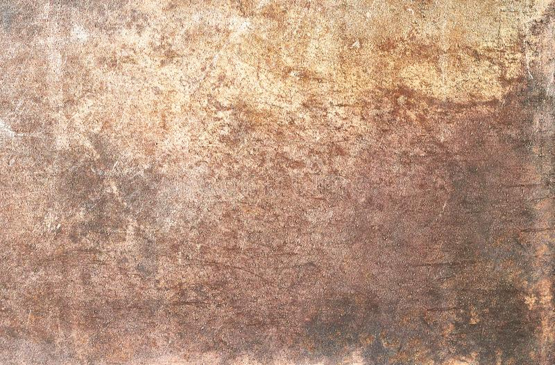 Metallic bronze textured background. With pattern of round cells in line royalty free stock photo