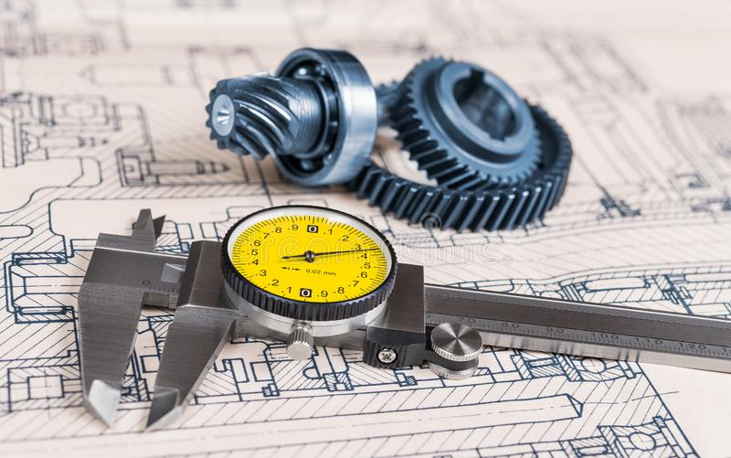 Metallic caliper. Technical drawing. Gear wheels. Ball bearing. Mechanical engineering stock image