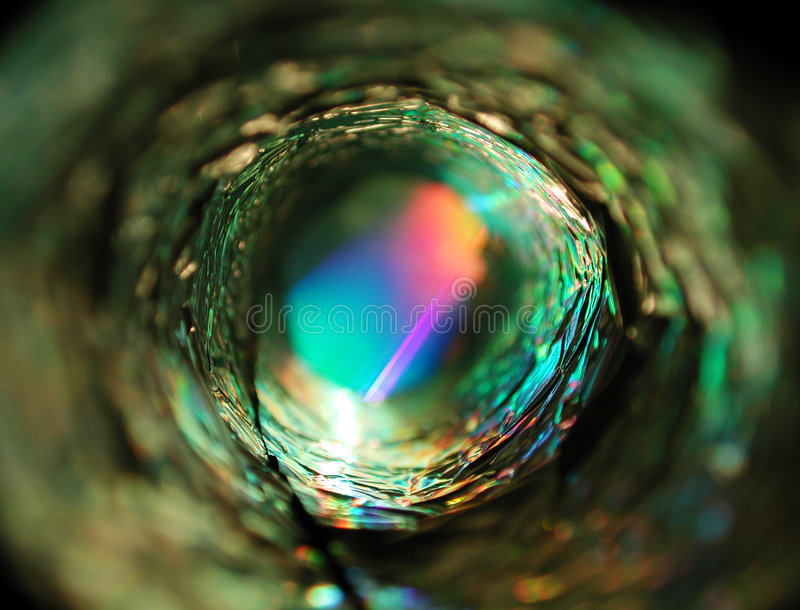 Metallic Circle Glowing Light. An abstract tunnel or tube shaped texture created with light and metal. Very bizarre stock image