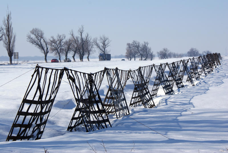 Metallic fence against snow storm royalty free stock photos
