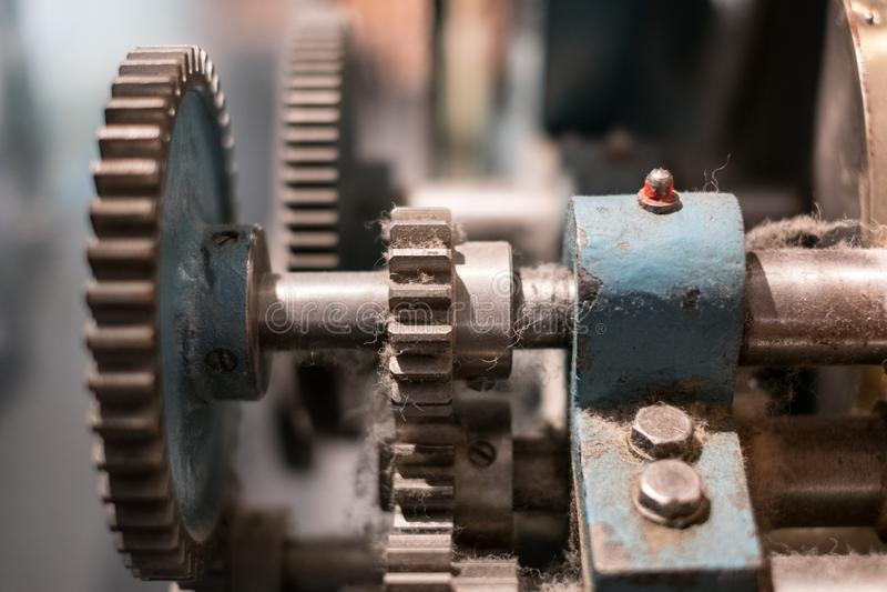 Metallic gears, closeup, of vintage machine - mechanical technology concept, stock photo