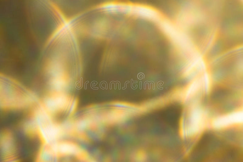 Metallic Gold yellow Lights Festive background. Abstract Christmas twinkled bright background with bokeh defocused silver lights stock photos