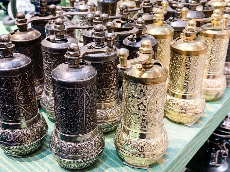 Metallic and golden herb and spices grinders in a traditional Turkish and Arabic style for kitchenware royalty free stock image