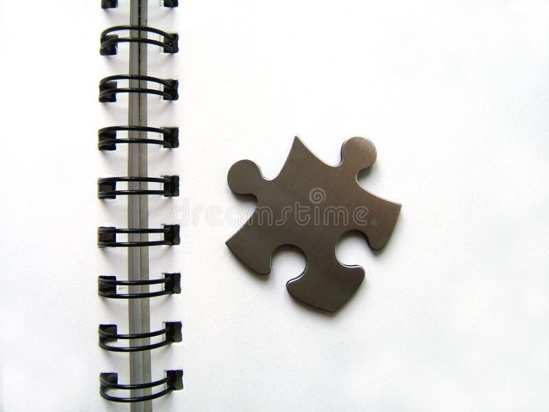Download Metallic Jigsaw On Notebook Stock Image - Image: 513389
