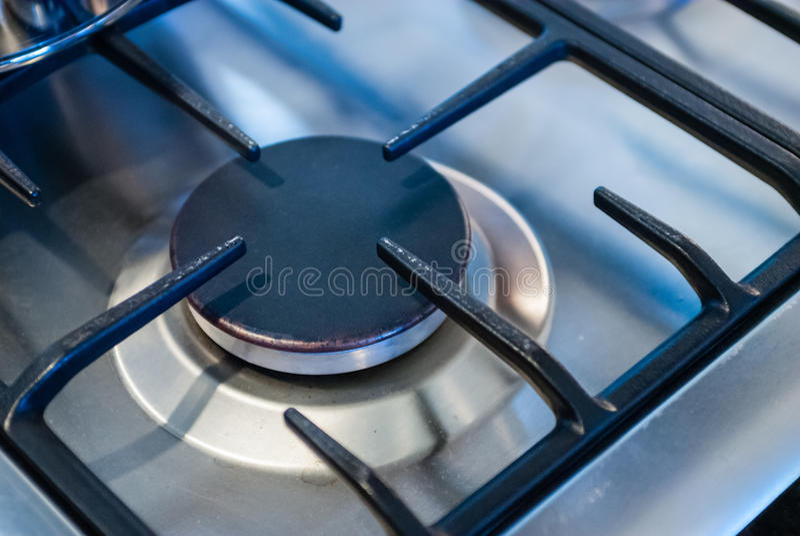 Metallic kitchen stove burner and frame stock image