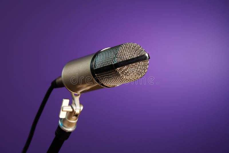 Metallic microphone on purple stock photo