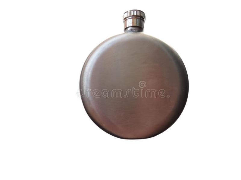 The metallic nickel-plated flask is round with a metal cap stock photos