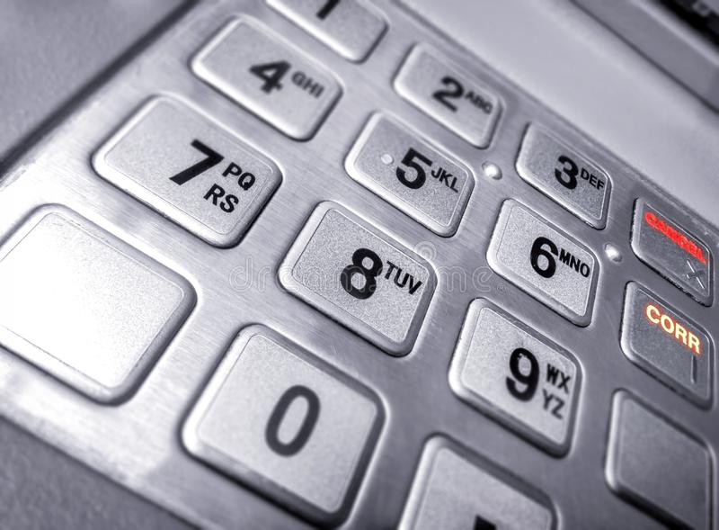 Metallic Numeric Input Keypad on an Automated Teller Machine. royalty free stock photography
