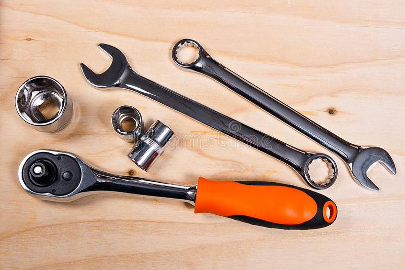 Metallic spanners on the wooden background stock image