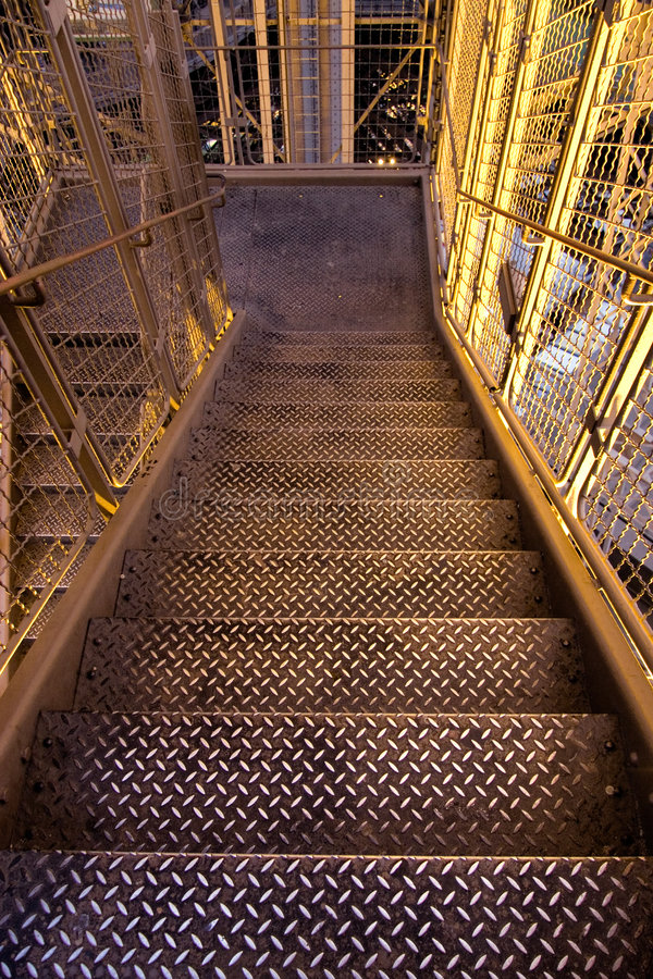 Metallic stairs on a factory royalty free stock photo