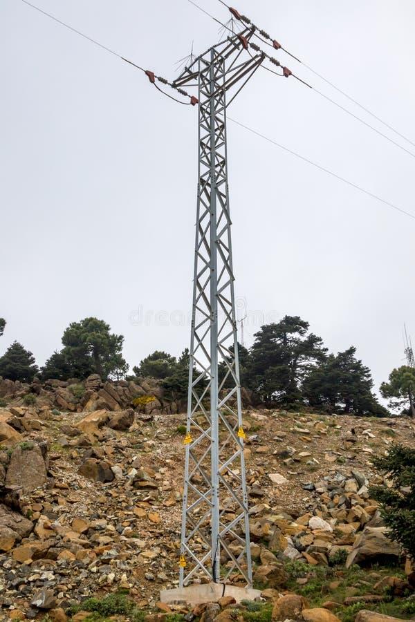 Electric pylon in the mountais of Estepona stock photography