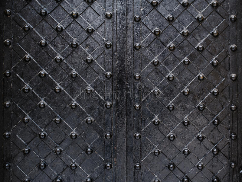 Metallic texture black elements of the old door stock photography