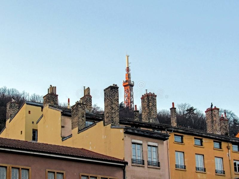 Metallic tower of Fourviere, steel framework tower with rooftops and chimneys, Lyon, France, Europe. Metallic tower of Fourviere, Tour metallique de Fourviere, a stock images