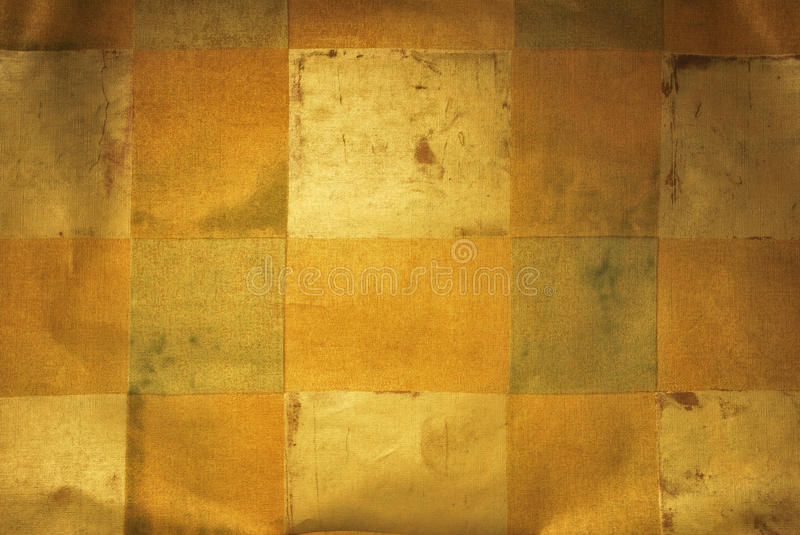 Metallic Wallpaper with Square Design. Golden metallic wallpaper with abstract square design, slightly wrinkled with light focused center to ad depth, display stock illustration