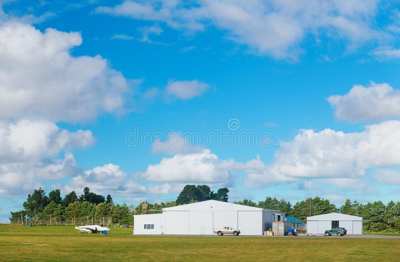 Metallic warehouse with blue sky royalty free stock photography