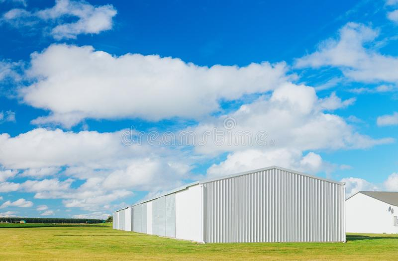Metallic warehouse with blue sky royalty free stock photo