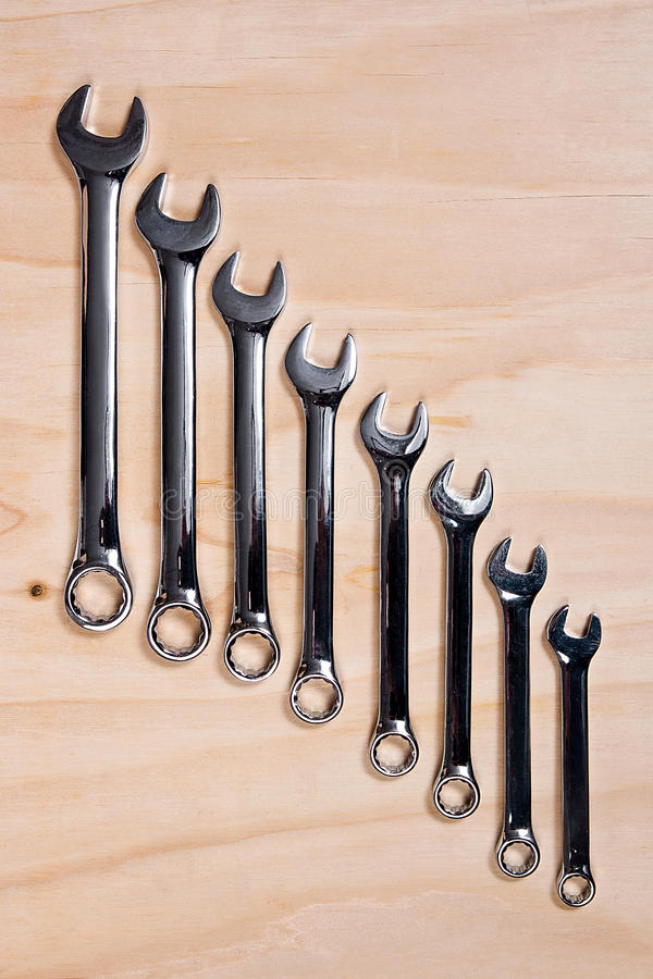 Metallic wrench on the wooden background stock images