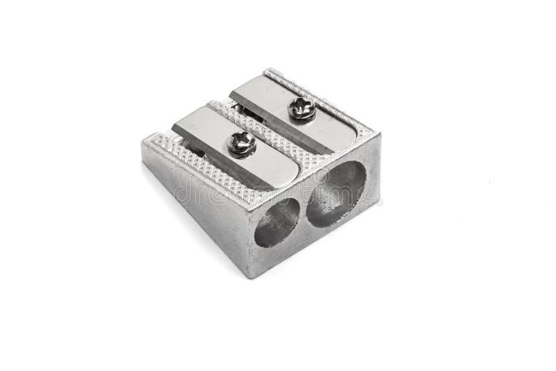 Metallischer Bleistiftspitzer mit dem doppelten Loch lokalisiert auf weißem Hintergrund stockfotografie