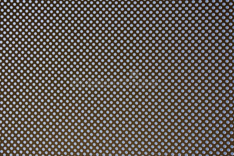 Metallischer Rahmen mit gerundeten Löchern, Hintergrund mit Perforierung stockfotografie
