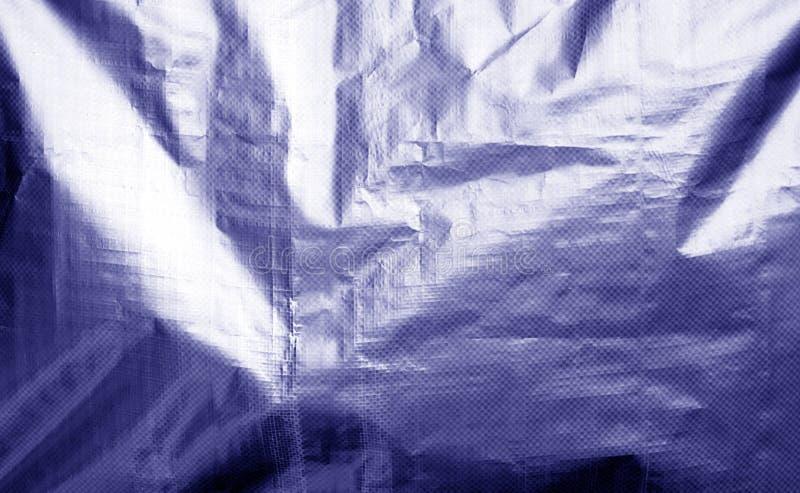 Metallisierte Plastikhüllebeschaffenheit mit zerknittert in der blauen Farbe lizenzfreie stockfotografie