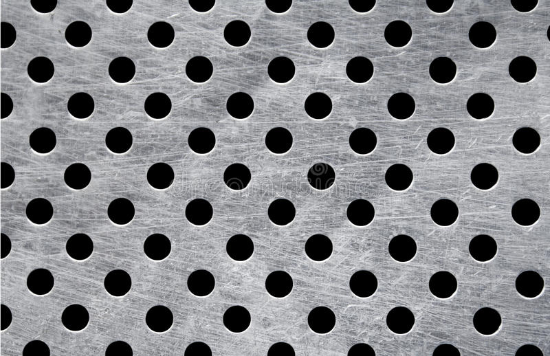 metallisk platta för fulla hål royaltyfria foton
