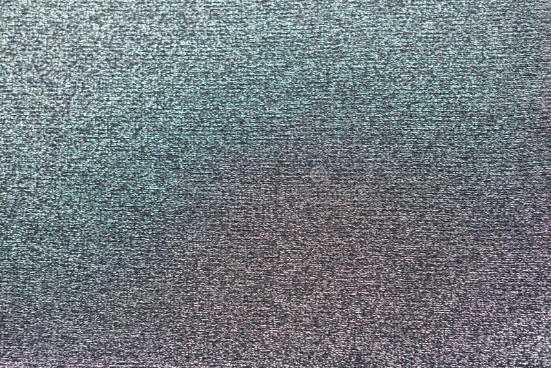 Metallisk virkad tygtextur, med liten purpurfärgad och grön färg royaltyfri fotografi