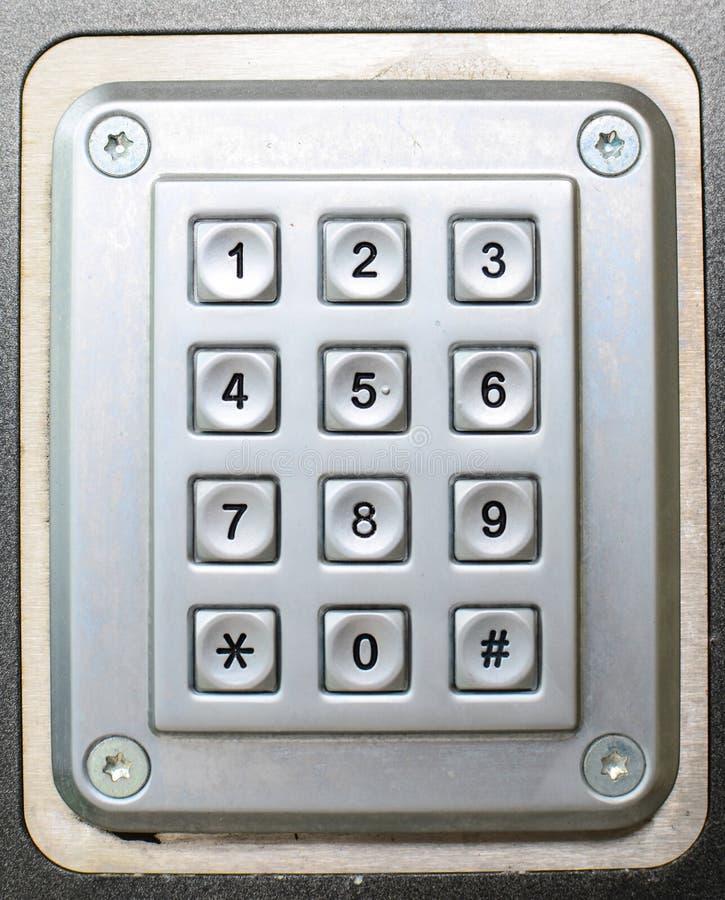 Metallknopftelefon-Tastaturhintergrund lizenzfreie stockfotografie