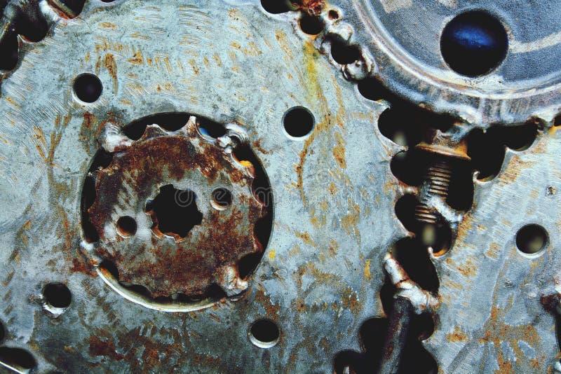 Metallkugghjul och kugghjulbakgrund arkivbilder