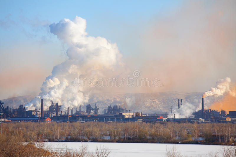 Metallurgical factory. Environmental contamination. Smoke pipe stock images