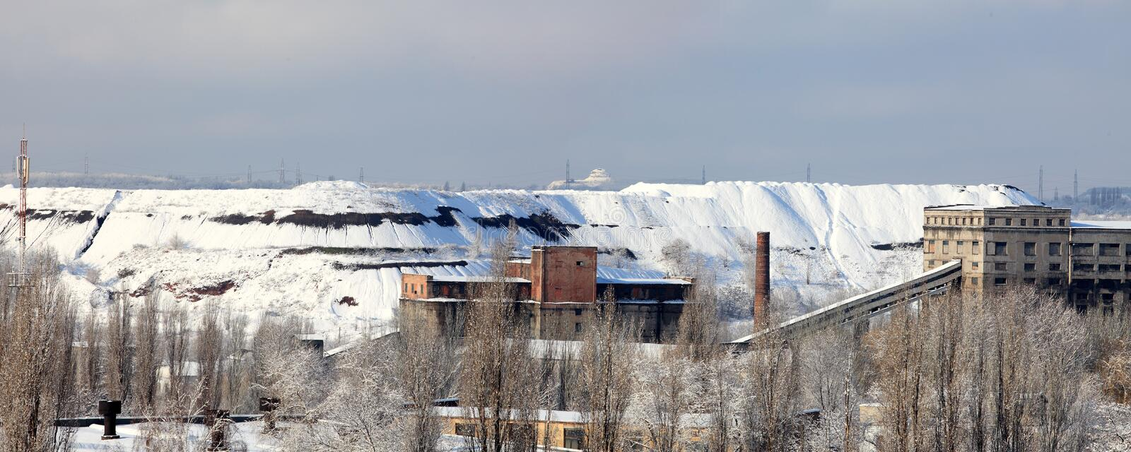 Metallurgical factory in the winter. Mountain royalty free stock photo