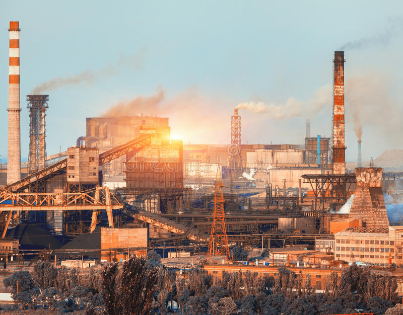 Metallurgical plant at colorful sunset. Industrial landscape. St. Eel factory in the city. Steel works, iron works. Heavy industry in Ukraine. Air pollution stock image