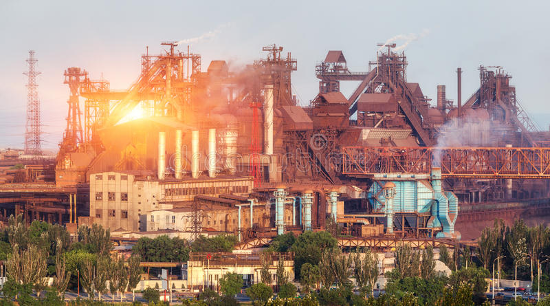 Metallurgical plant at colorful sunset. Industrial landscape. St. Eel factory in the city. Steel works, iron works. Heavy industry in Ukraine. Air pollution stock photography