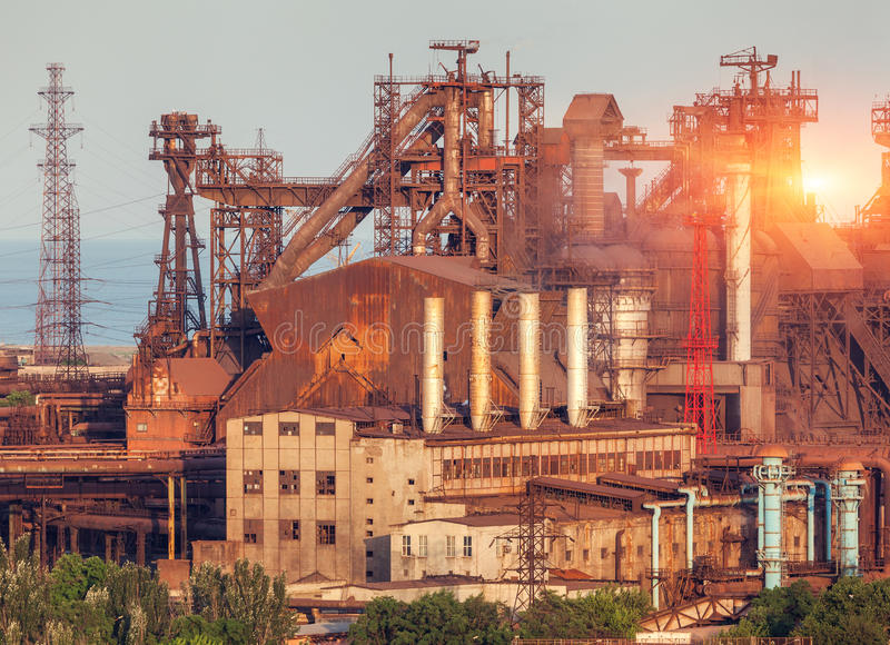 Metallurgical plant at colorful sunset. Industrial landscape. St royalty free stock photo