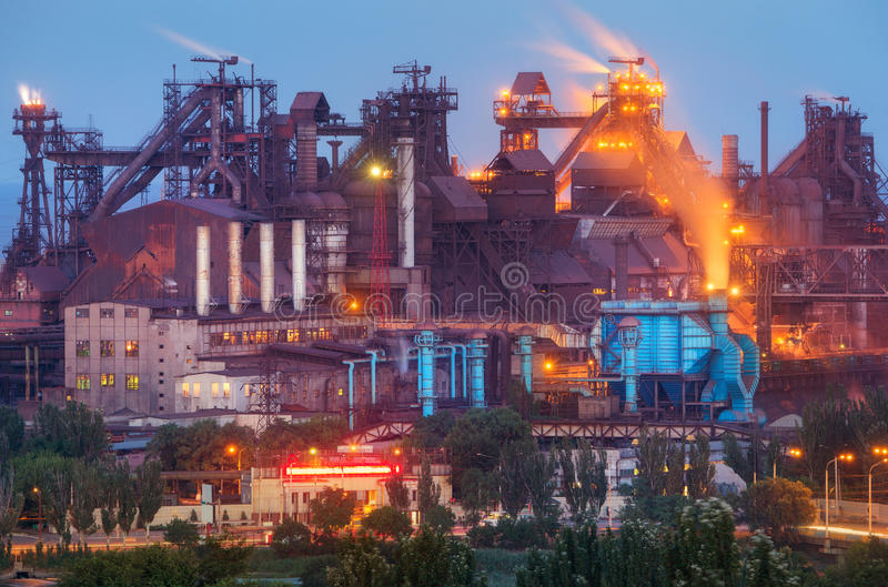 Metallurgical plant with white smoke at night. Steel factory with smokestacks . Steelworks, iron works. Heavy industry. Metallurgical plant at night. Steel royalty free stock image