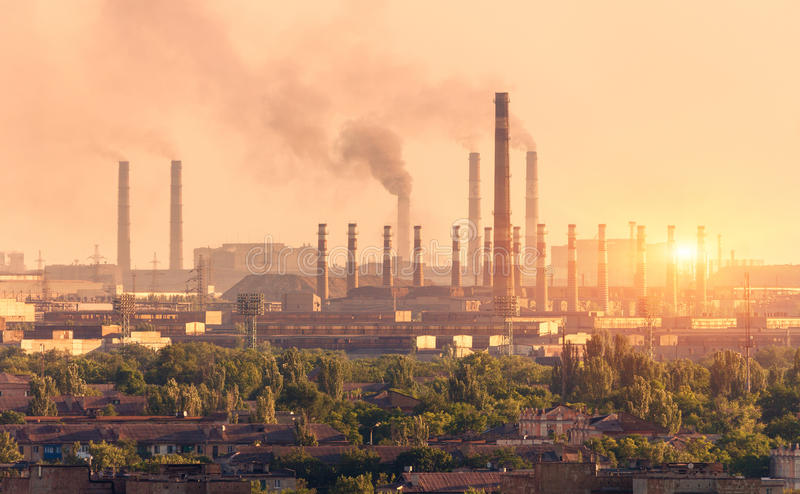 Metallurgy plant at sunset. Steel mill. Heavy industry factory. Steel factory with smog. Pipes with smoke. Metallurgical plant in city. steel, iron works stock images