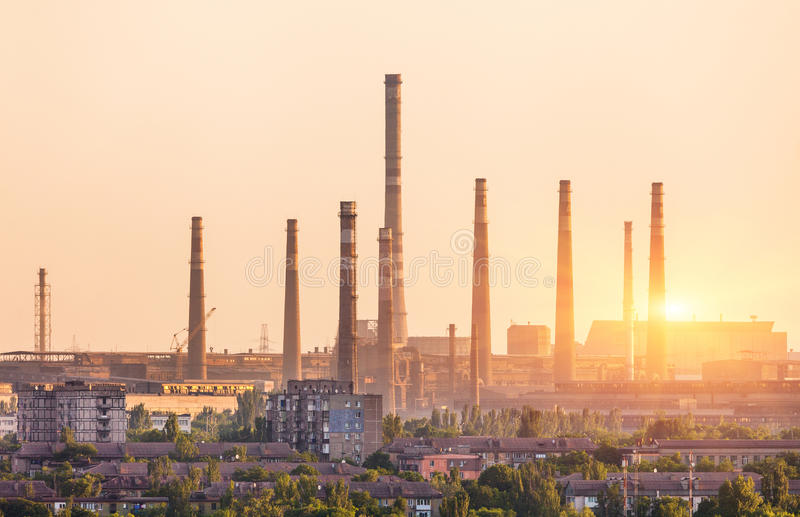 Metallurgy plant at sunset. Steel mill. Heavy industry factory. Steel factory with smog. Pipes with smoke. Metallurgical plant in city. steel, iron works stock photo