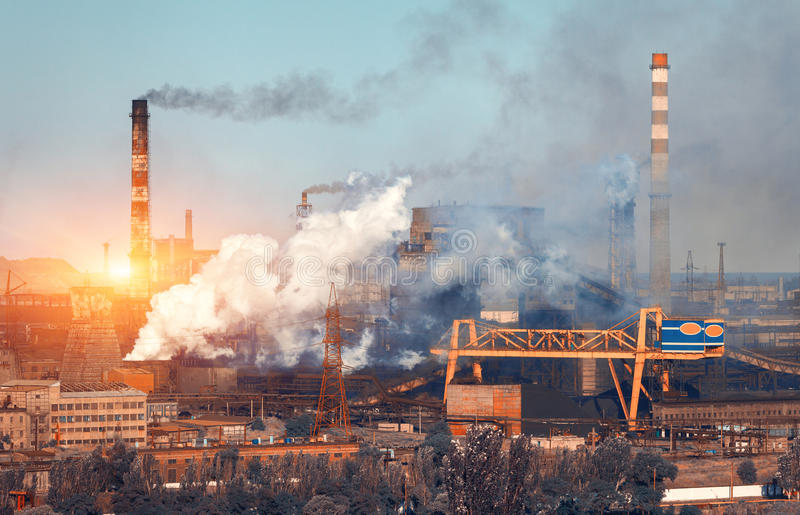 Metallurgy plant in Ukraine at sunset. Steel factory with smog. Pipes with smoke. Steel mill. Heavy industry factory. Metallurgical plant in city. Steel works stock images