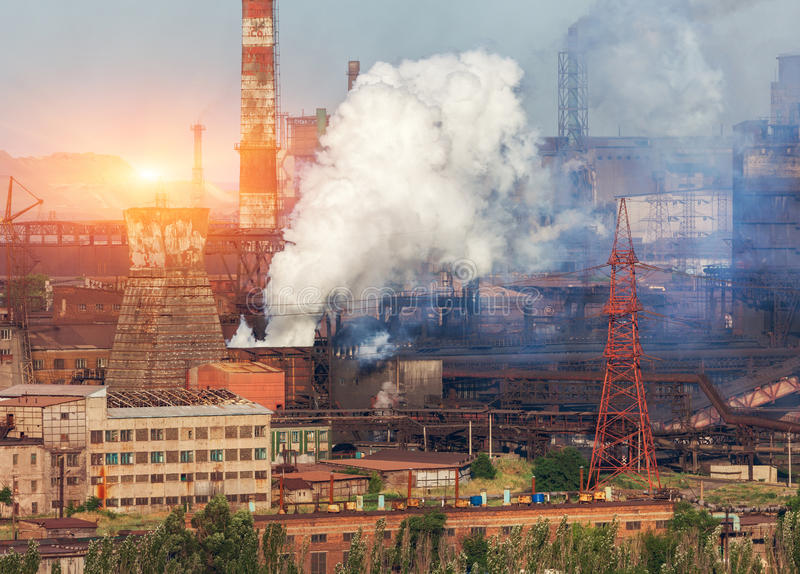 Metallurgy plant in Ukraine at sunset. Steel factory with smog. Pipes with smoke. Steel mill. Heavy industry factory. Metallurgical plant in city. Steel works royalty free stock image