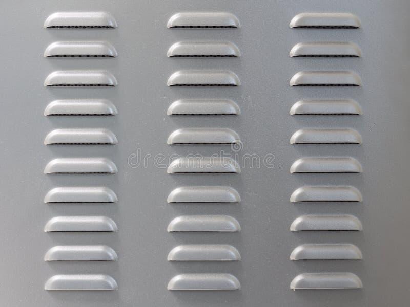 Metallyttersida med perforering för luftlufthål fotografering för bildbyråer