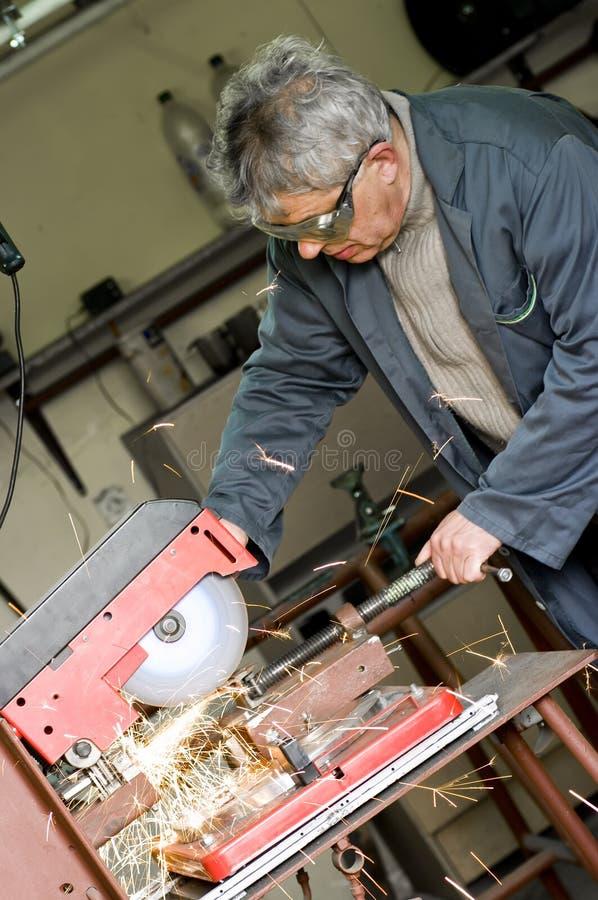 Metalworker Cutting Metal Stock Photo