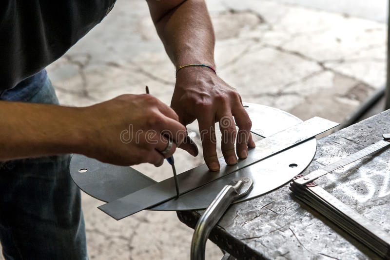 Metalworker making precision measurement stock photography